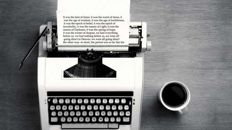 Typewriter and cup of coffee