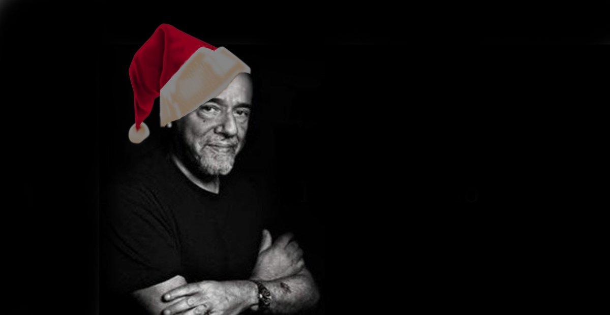 paolo coehlo in a santa hat